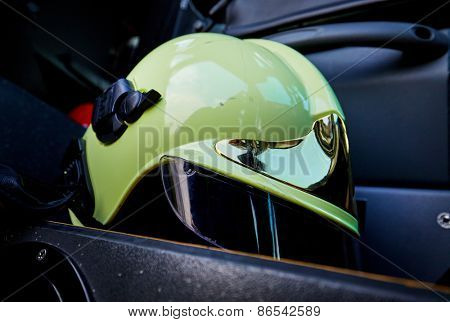 close-up picture of a white fire helmet on car seat