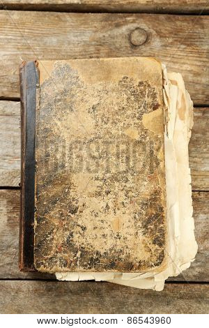 Old book on wooden table
