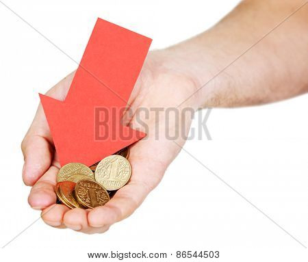 Male hand holding coins and red arrow on light background