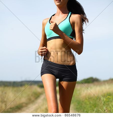 young Woman Runner. Fitness Girl Running outdoors