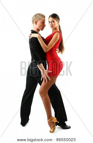 Beautiful couple of professional artists dancing isolated on white