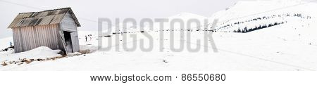 Wooden building over snow in wintertime