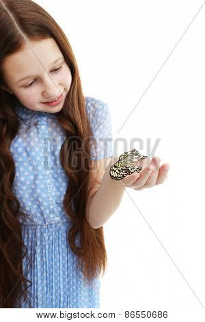 Little girl playing with butterfly, isolated on white