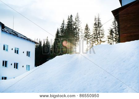 Building over snow and trees in wintertime