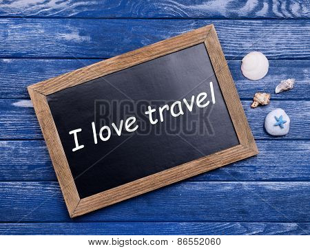 Travel inscription on wooden background