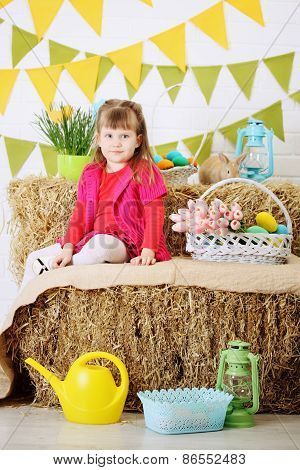 Girl Sitting On A Haystack