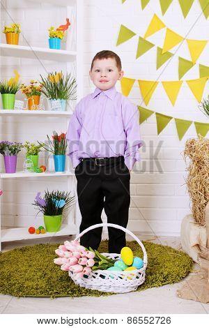 Boy Standing Near The Basket