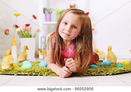 Girl Lying With Ducklings