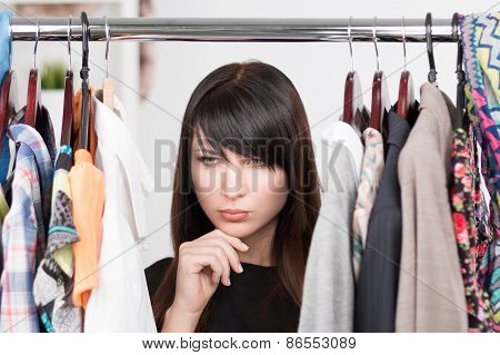 Beautiful Young Woman Near Rack With Clothesc