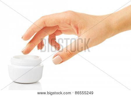 Female hand with jar of cream isolated on white