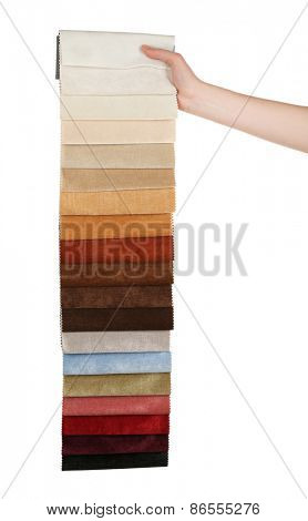 Female hand holding scraps of colored tissue isolated on white