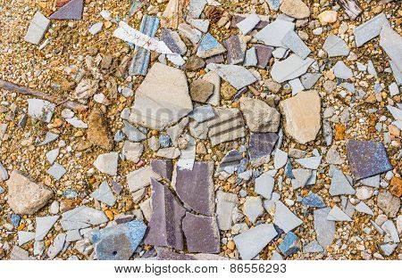 Image Of Small Pebble Rock On Cracked Cement Ground  Texture.