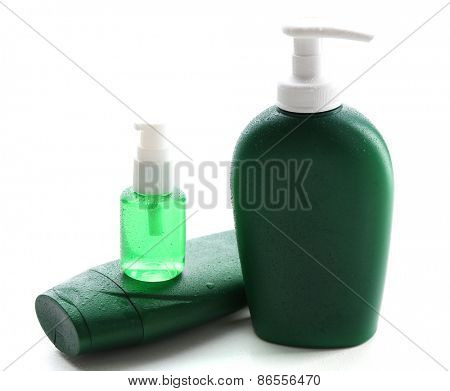 Cosmetic bottles isolated on white
