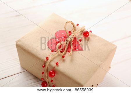 Beautiful gift box on wooden table. Valentine Day concept