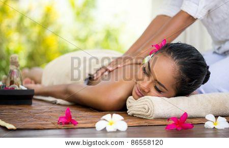Beautiful Balinese woman getting a massage