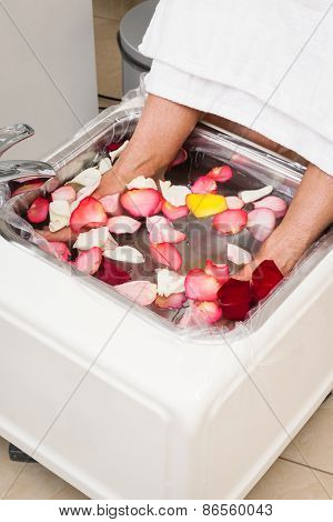 bath with rose leaf in pedicure