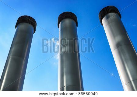 metal pipes against the blue sky