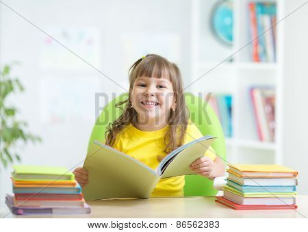 Happy kid with opened book