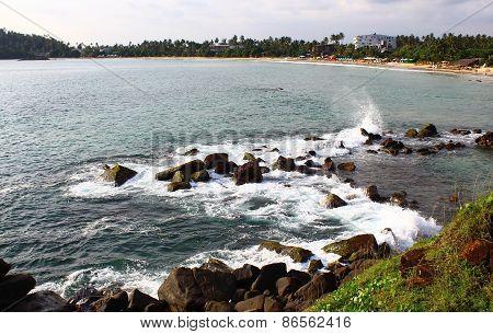 Waves hit the rocks on the beach, Mirissa