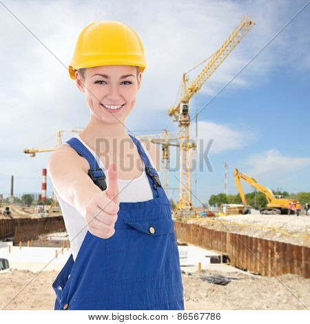 Beautiful Woman Builder In Blue Coveralls Thumbs Up