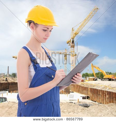 Attractive Woman Builder Writing Something In Clipboard