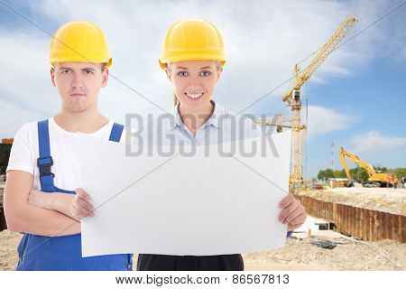 Business Woman Architect And Man Builder In Yellow Helmet