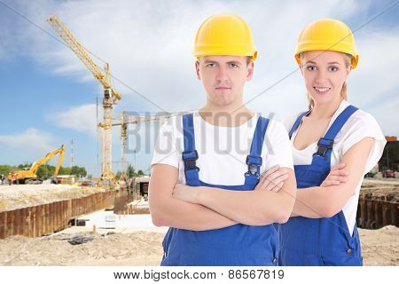 Young Man And Woman In Blue Builder 's Uniform