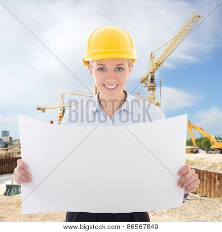 Business Woman Architect In Yellow Builder Helmet Holding Building Plan