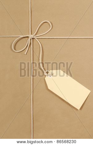 Brown Parcel With Cream Cotton String And Large Label