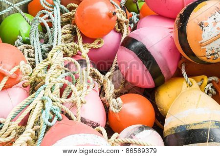 Close up of an old collection of brightly colored buoys on the Riverton jetty,