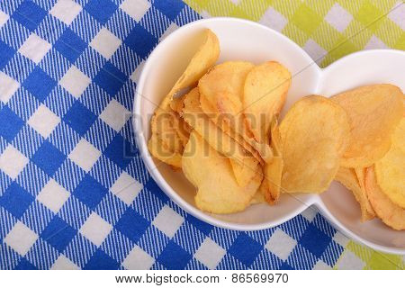 Close-up Of Fresh, Crispy Potato Chips In A Wooden Bowl On A White Background.