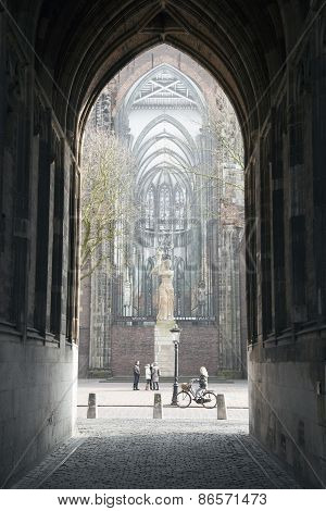Tourists In Centre Of Utrecht Seen From Under The Dom Tower