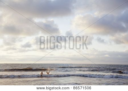 The Hague, Netherlands, 10 August 2012: Two Children Play In The Surf Of The North Sea On The Dutch