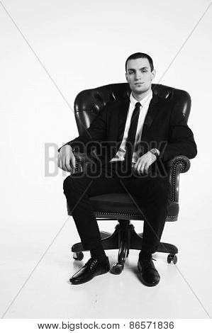 Business man sitting on a green