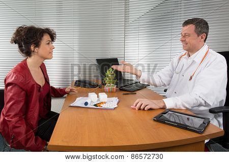 Doctor Receiving  A Woman Pharmaceutical Sales Representative