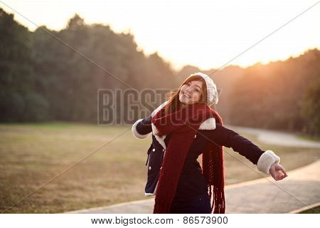 Girl Stretching Arms To Relax With Sunset