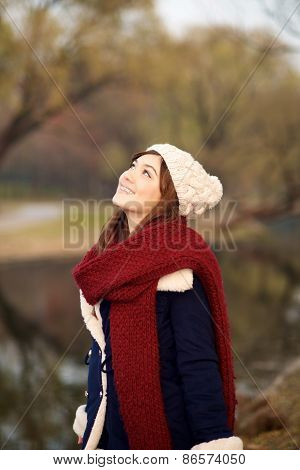 Beautiful Girl Looking Up In Winter Clothes
