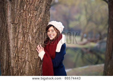 Beautiful Girl Hugging Tree