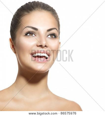 Beauty smiling woman. Healthy Smile. Teeth Whitening. Beautiful Smiling Young girl Portrait isolated on a  White background. Laughing brunette female