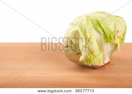 Iceberg Lettuce On Wooden Table