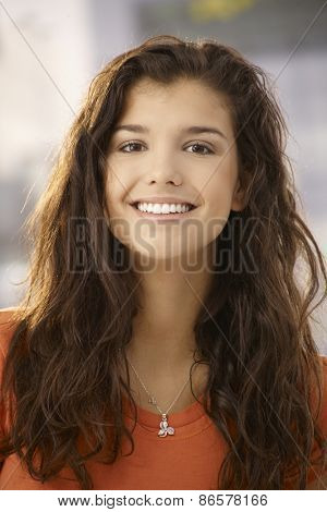 Closeup portrait of beautiful young woman smiling happy at camera.