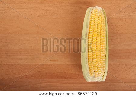 Sweetcorn On Wooden Table