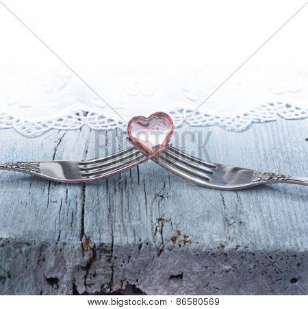 two forks with little heart, concept of love
