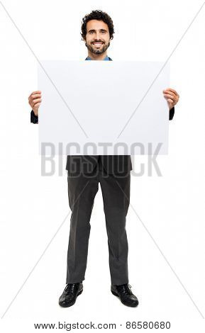 Handsome businessman showing a blank board