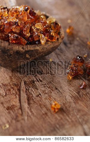 Gum arabic, also known as acacia gum - in old wooden spoon