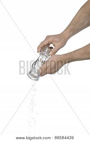Two Male Hands Using A Salt Grinder