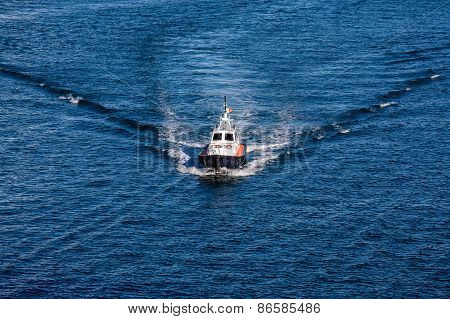 Pilot Boat Cutting Through Blue Water