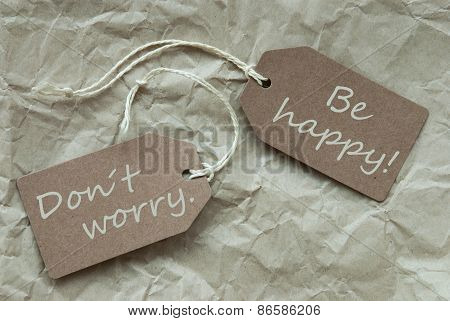 Two Beige Labels With Quote Dont Worry Happy Paper Background