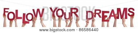 People Hands Holding Red Word Follow Your Dreams