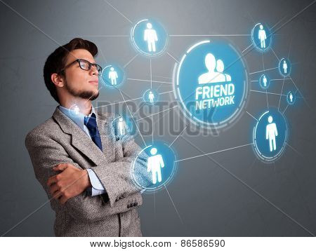 Handsome young man looking at modern social network